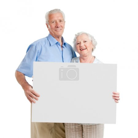Happy loving couple with sign