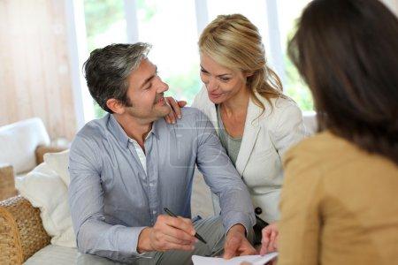 Couple meeting advisor at home