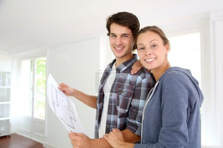 New property owners looking at home blueprint