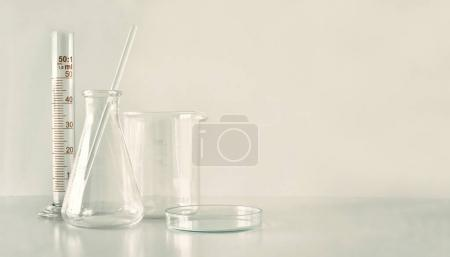 Group of laboratory glassware on table, Symbolic of science.