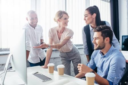 business people with desktop computer