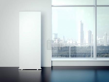 Blank white vertical banner in the office interior . 3d rendering