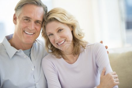 Couple Smiling Together At Home