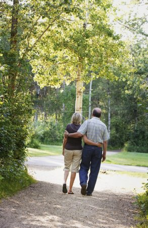 Husband And Wife On Walking Trail