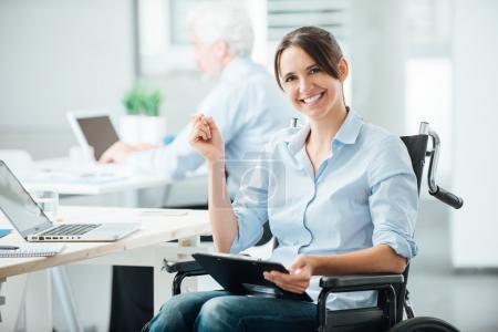 Happy office worker in wheelchair