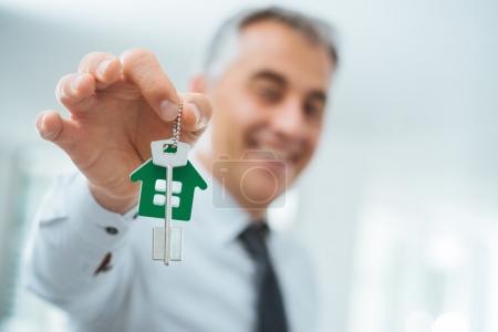 Real estate agent holding house keys