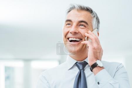 Confident businessman on the phone